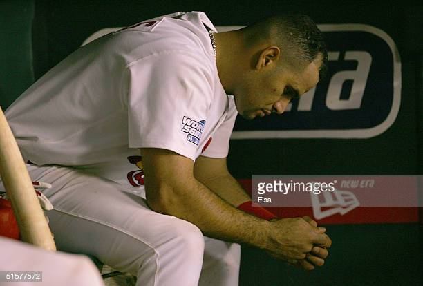Albert Pujols of the St Louis Cardinals sits dejected in the dugout in the eighth inning during game three of the World Series against the Boston Red...