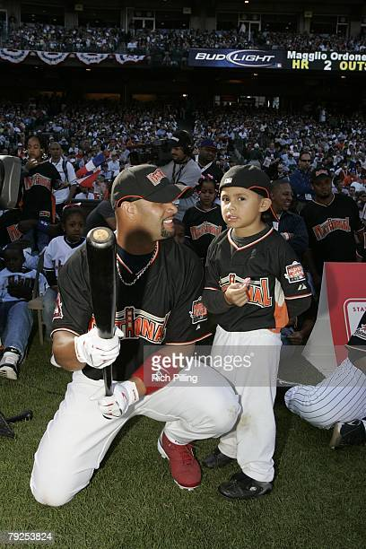 Albert Pujols of the St Louis Cardinals sits with son before the Home Run Derby at ATT Park in San Francisco California on July 9 2007