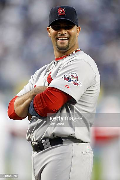 Albert Pujols of the St Louis Cardinals smiles during pregame introductions before taking on the Los Angeles Dodgers in Game One of the NLDS during...