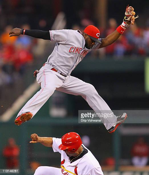 Albert Pujols of the St. Louis Cardinals steals second base against Brandon Phillips of the Cincinnati Reds at Busch Stadium on April 24, 2011 in St....
