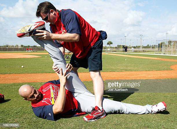 Albert Pujols of the St Louis Cardinals stretches prior to batting practice at Roger Dean Stadium on February 17 2011 in Jupiter Florida