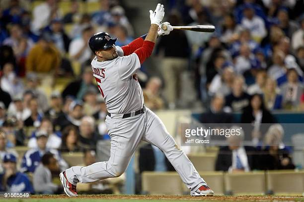 Albert Pujols of the St Louis Cardinals swings against the Los Angeles Dodgers in Game One of the NLDS during the 2009 MLB Playoffs at Dodger Stadium...