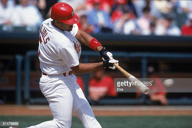 Albert Pujols of the St Louis Cardinals swings at the pitch during the game against the Houston Astros at Busch Stadium on April 15 2001 in St Louis...