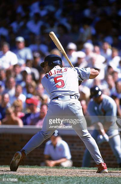 Albert Pujols of the St Louis Cardinals swings at the pitch during the game against the Chicago Cubs at Wrigley Field on July 26 2001 in Chicago...