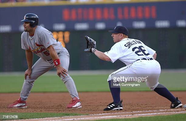 Albert Pujols of the St Louis Cardinals takes a lead next to Chris Shelton of the Detroit Tigers during the game at Comerica Park in Detroit Michigan...