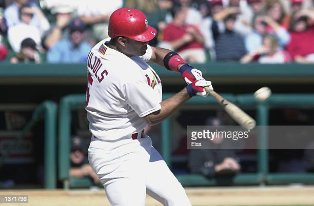 Albert Pujols of the St Louis Cardinals takes a swing during the game against the Houston Astros on October 8 2001 at Busch Stadium in St Louis...
