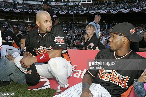 Albert Pujols of the St Louis Cardinals talks to Jose Reyes of the New York Mets during the Home Run Derby at ATT Park in San Francisco California on...