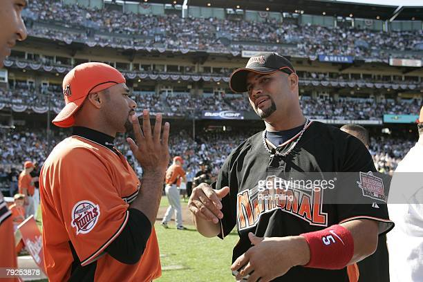 Albert Pujols of the St Louis Cardinals talks with Johan Santana of the Minnesota Twins before the Home Run Derby at ATT Park in San Francisco...