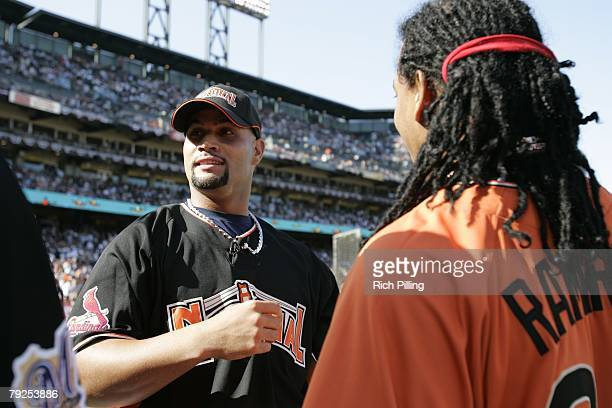 Albert Pujols of the St Louis Cardinals talks with Manny Ramirez of the Boston Red Sox before the Home Run Derby at ATT Park in San Francisco...
