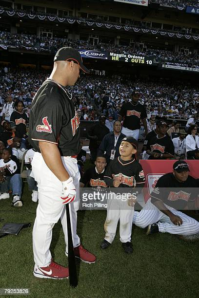 Albert Pujols of the St Louis Cardinals talks with son before the Home Run Derby at ATT Park in San Francisco California on July 9 2007