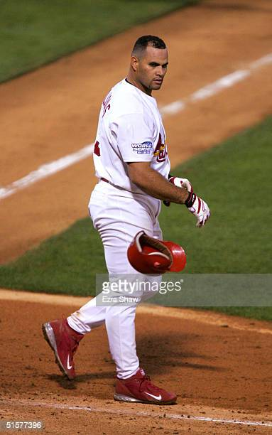 Albert Pujols of the St Louis Cardinals throws his helmet after striking out to end the sixth inning against the Boston Red Sox during game three of...