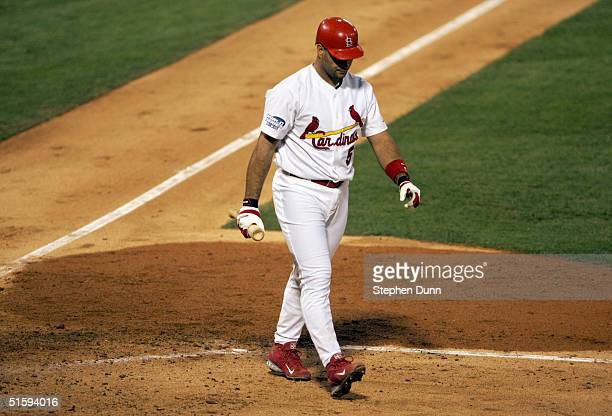 Albert Pujols of the St Louis Cardinals walks back to the dugout after striking out in the fourth inning against the Boston Red Sox during game four...