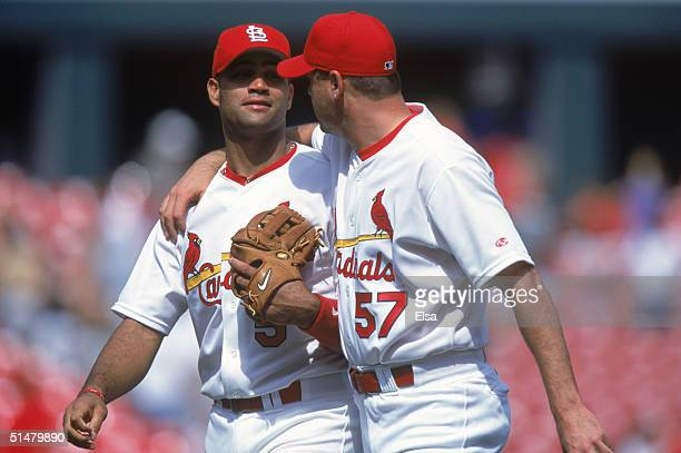 Albert Pujols of the St Louis Cardinals walks with Darryl Kile during the game against the Pittsburgh Pirates at Busch Stadium on May 10 2001 in St...