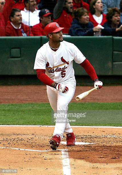 Albert Pujols of the St Louis Cardinals watches his tworun homerun in the bottom of the first inning against the Houston Astros in game six of the...
