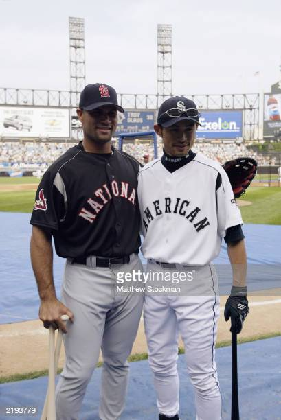 Albert Pujols poses with Ichiro Suzuki during batting practice before the Home Run Derby for the 74th Major League Baseball All Star Game on July 14,...