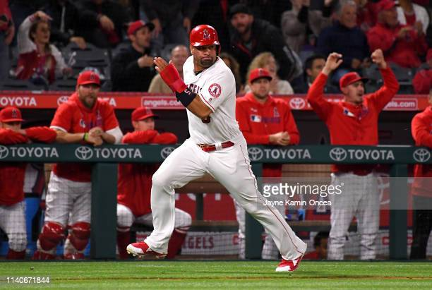 Albert Pujols the Los Angeles Angels of Anaheim of heads home to score a run on a double by Kole Calhoun in the fifth inning of the game against the...