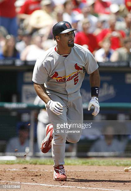 Albert Pujols watches his 22nd home run of the season leave the park during action between the St Louis Cardinals and Kansas City Royals at Kauffman...
