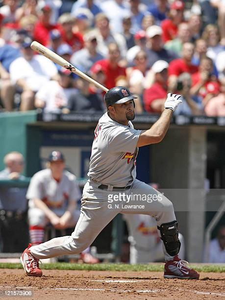 Albert Pujols watches his 22nd home run of the year sail out of the park during action between the St Louis Cardinals and Kansas City Royals at...