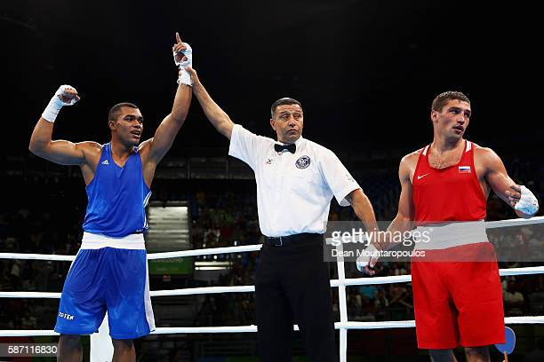 Albert Ramon Ramirez of Venezuela celebrates victory against Petr Khamukov of Russia in the Men's Light Heavy 81kg bout on Day 2 of the Rio 2016...