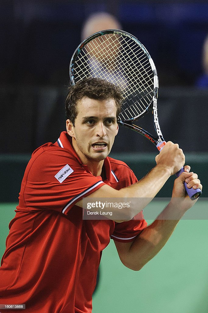 Albert Ramos of Spain eyes the ball during his singles match against Frank Dancevic of Canada on day three of the 2013 Davis Cup on February 3, 2013 at UBC Thunderbird Arena in Vancouver, British Columbia, Canada. Albert defeated Frank.