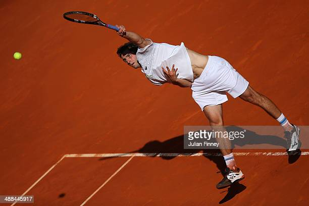 Albert Ramos of Spain in action against David Ferrer of Spain during day four of the Mutua Madrid Open tennis tournament at the Caja Magica on May 6...