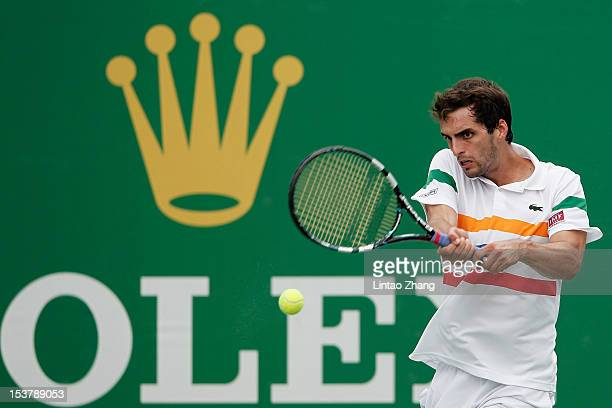 Albert Ramos of Spain returns a shot to Stanislas Wawrinka of Switzerland during the day three of Shanghai Rolex Masters at the Qi Zhong Tennis...