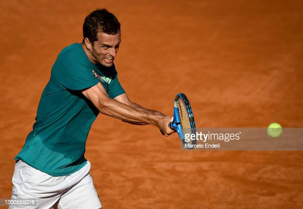 Albert Ramos Vinolas of Spain hits a backhand during his Men's Singles match against Pablo Cuevas of Uruguay during day 4 of ATP Buenos Aires...
