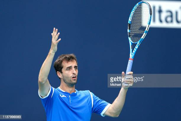 Albert Ramos Vinolas of Spain reacts during his match against John Isner of the United States during Day 7 of the Miami Open Presented by Itau at...