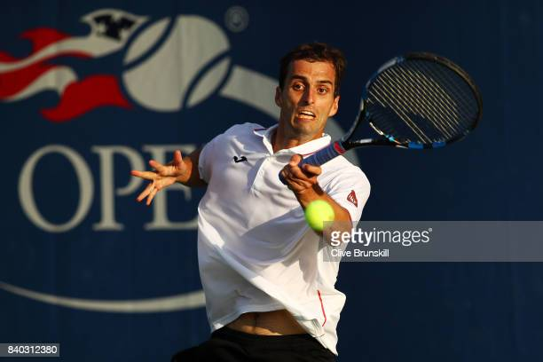 Albert Ramos Vinolas of Spain returns a shot during his first round Men's Singles match against Denis Istomin of Uzbekistan on Day One of the 2017 US...