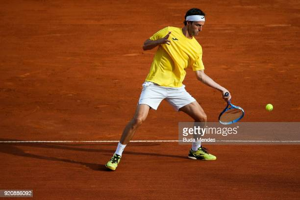 Albert Ramos Vinolas of Spain returns a shot to Rogerio Dutra Silva of Brazil during the ATP Rio Open 2018 at Jockey Club Brasileiro on February 19...