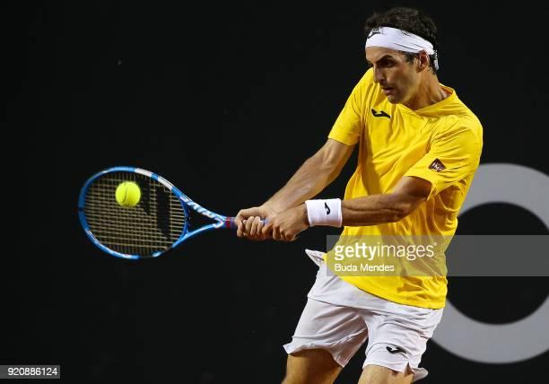 Albert Ramos Vinolas of Spain returns a shot to Rogerio Dutra Silva of Brazil during the ATP Rio Open 2018 at Jockey Club Brasileiro on February 19...