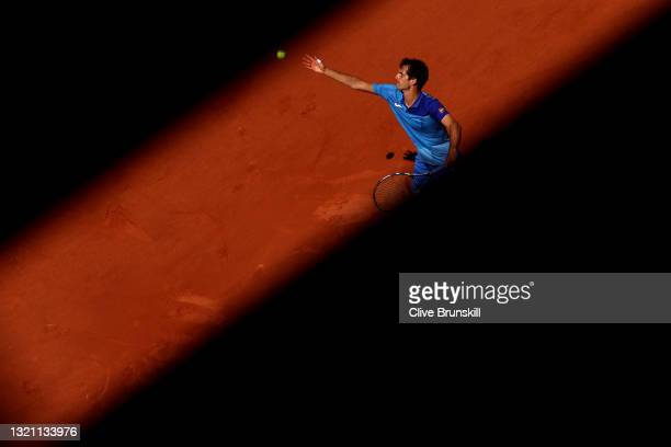Albert Ramos Vinolas of Spain serves in their mens first round match against Gael Monfils of France during day three of the 2021 French Open at...