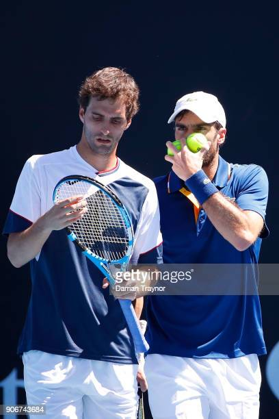 Albert RamosVinolas of Spain and Pablo Andujar of Spain talk tactics in their second round men's doubles match against Steve Johnson of the United...