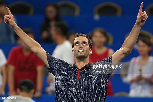 Albert Ramos-Vinolas of Spain celebrates after winning the semi final match against Grigor Dimitrov of Bulgaria during Day 6 of 2016 ATP Chengdu Open...