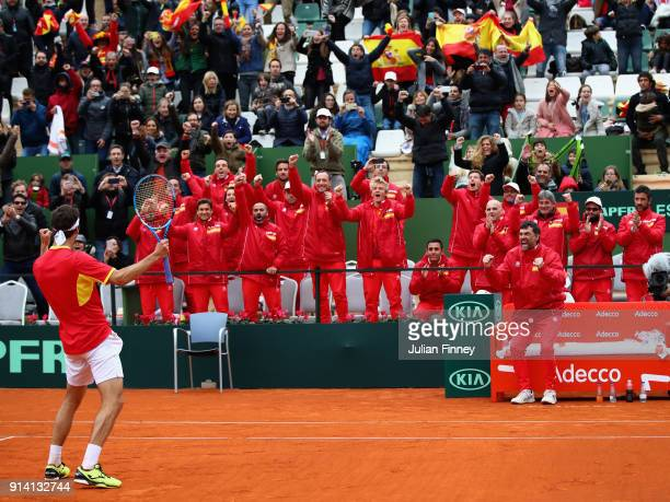 Albert RamosVinolas of Spain celebrates in front of his team after he defeated Cam Norrie of Great Britain in four sets during day three of the Davis...