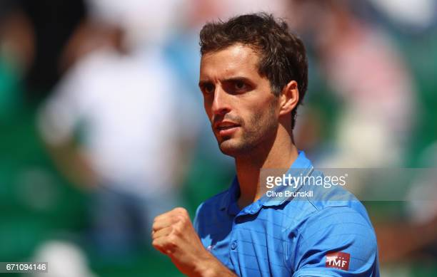 Albert RamosVinolas of Spain celebrates to his team bench after his three set victory against Marin Cilic of Croatia in their quarter final round...
