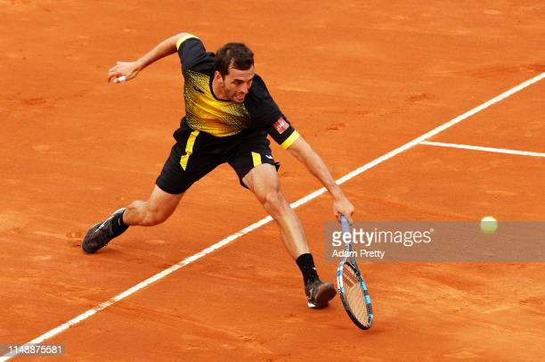 Albert Ramos-Vinolas of Spain hits a backhand during his first round match against Gael Monfils of France during day two of the International BNL...