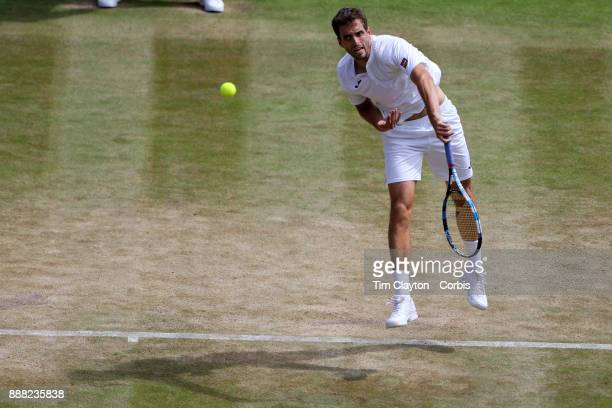 Albert RamosVinolas of Spain in action against Milos Raonic of Canada on number one court during the Wimbledon Lawn Tennis Championships at the All...