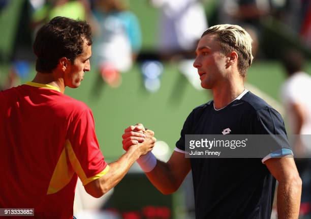 Albert RamosVinolas of Spain is congratulated by Liam Broady of Great Britain during day one of the Davis Cup World Group first round match between...