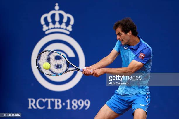 Albert Ramos-Vinolas of Spain plays a backhand against Andrey Rublev of Russia in their third round match during day four of the Barcelona Open Banc...
