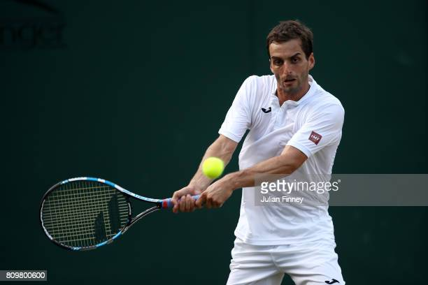Albert RamosVinolas of Spain plays a backhand during the Gentlemen's Singles second round match against Andrey Rublev of Russia on day four of the...