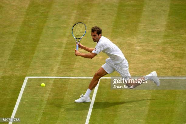 Albert RamosVinolas of Spain plays a backhand during the Gentlemen's Singles third round match against Milos Raonic of Canada on day six of the...