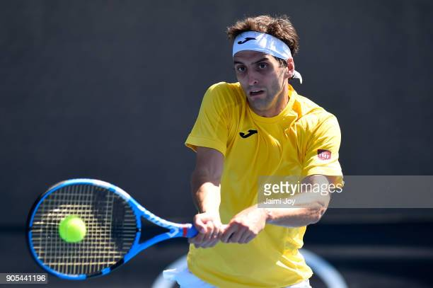 Albert RamosVinolas of Spain plays a backhand in his first round match against Jared Donaldson of the United States on day two of the 2018 Australian...