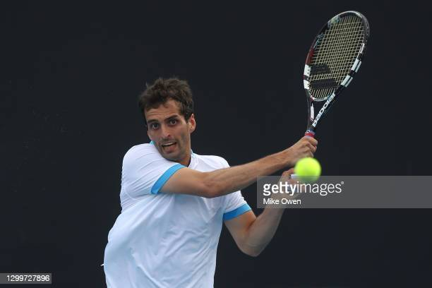 Albert Ramos-Vinolas of Spain plays a backhand in his match against Blake Mott of Australia during day one of the ATP 250 Murray River Open at...