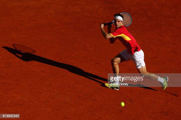 Albert RamosVinolas of Spain plays a backhand in his match against Liam Broady of Great Britain during day one of the Davis Cup World Group first...