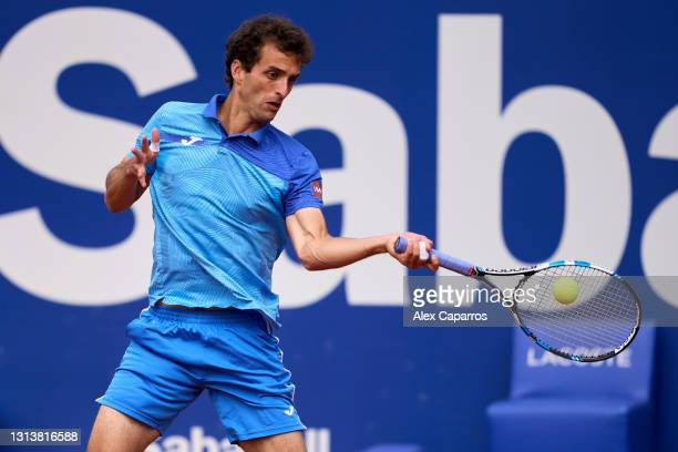 Albert Ramos-Vinolas of Spain plays a forehand against Andrey Rublev of Russia in their third round match during day four of the Barcelona Open Banc...
