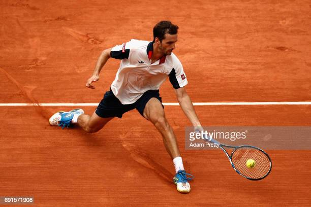 Albert RamosVinolas of Spain plays a forehand during mens singles third round match against Lucas Pouille of France on day six of the 2017 French...