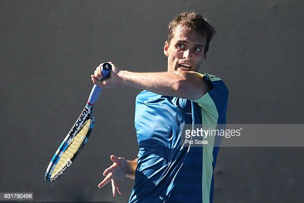 Albert RamosVinolas of Spain plays a forehand in his first round match against Lukas Lacko of Slovakia on day one of the 2017 Australian Open at...