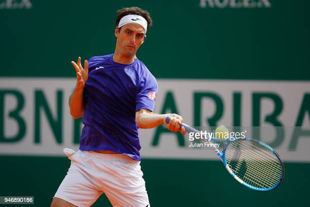 Albert RamosVinolas of Spain plays a shot in his match against Jared Donaldson of the USA during day two of ATP Masters Series Monte Carlo Rolex...