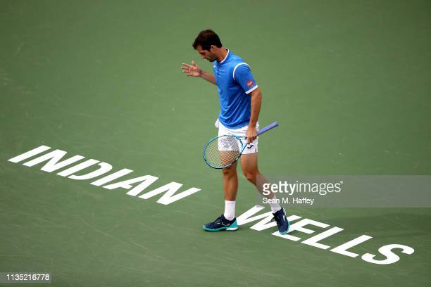 Albert RamosVinolas of Spain reacts to a call against during their men's singles third round match on Day 8 of the BNP Paribas Open at the Indian...